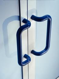 nylon coated handles, warm to the touch, in a contrasting colour such as these will comply with the dda