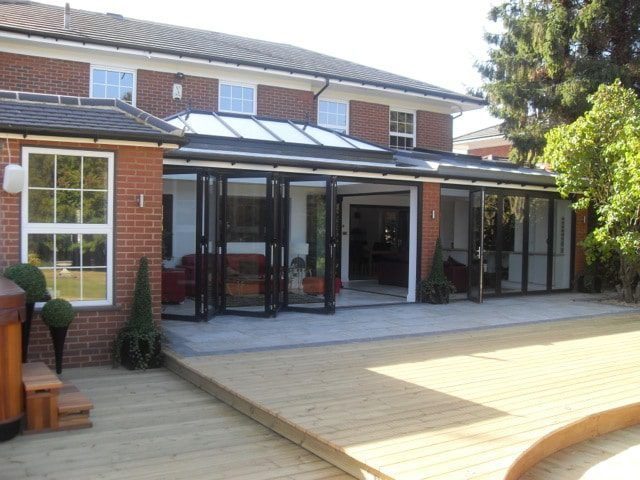 bifolding doors installed in this superb glazed extenson offer your living space unlimited options that a traditional conservatory simply cannot match.
