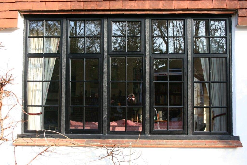 Black powder coated window in hardwood subframe with external crittall bars. Typical of country properties and cottages
