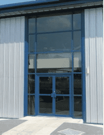 commercial door with hold open device