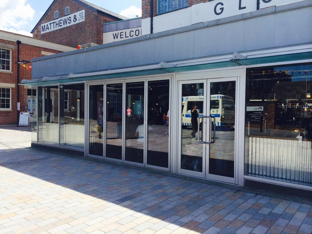 commercial shop doors fitted with concealed closers can be quickly changed to open in, out or double swing doors.