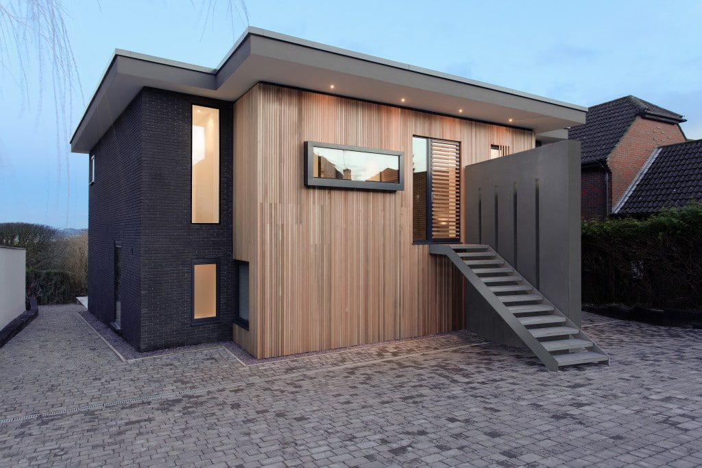 An aluminium entrance door enhanced with timber accessories to provide a unique door