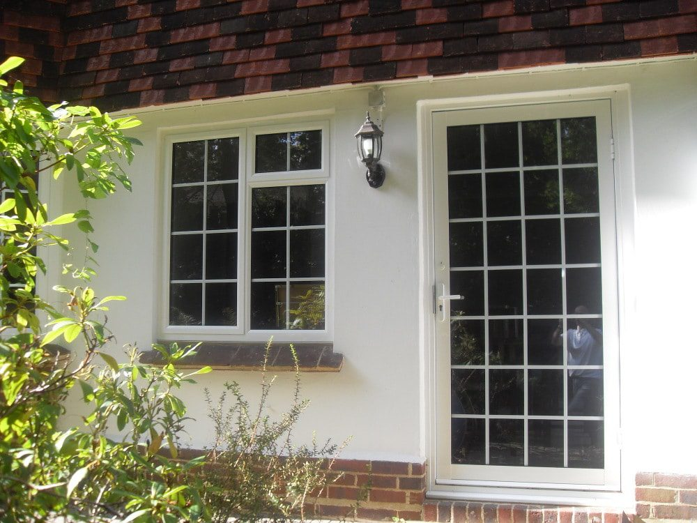 A typical casement window design with matching aluminium door. Here a pvc door would show bulky hinges and thicker profiles.