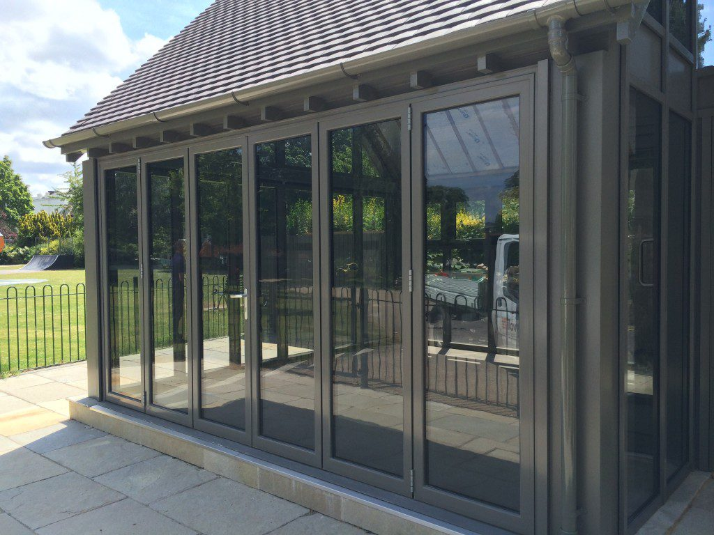 Typical bifolding doors even when ultra slim still have visible meeting stiles and thicker sight lines.