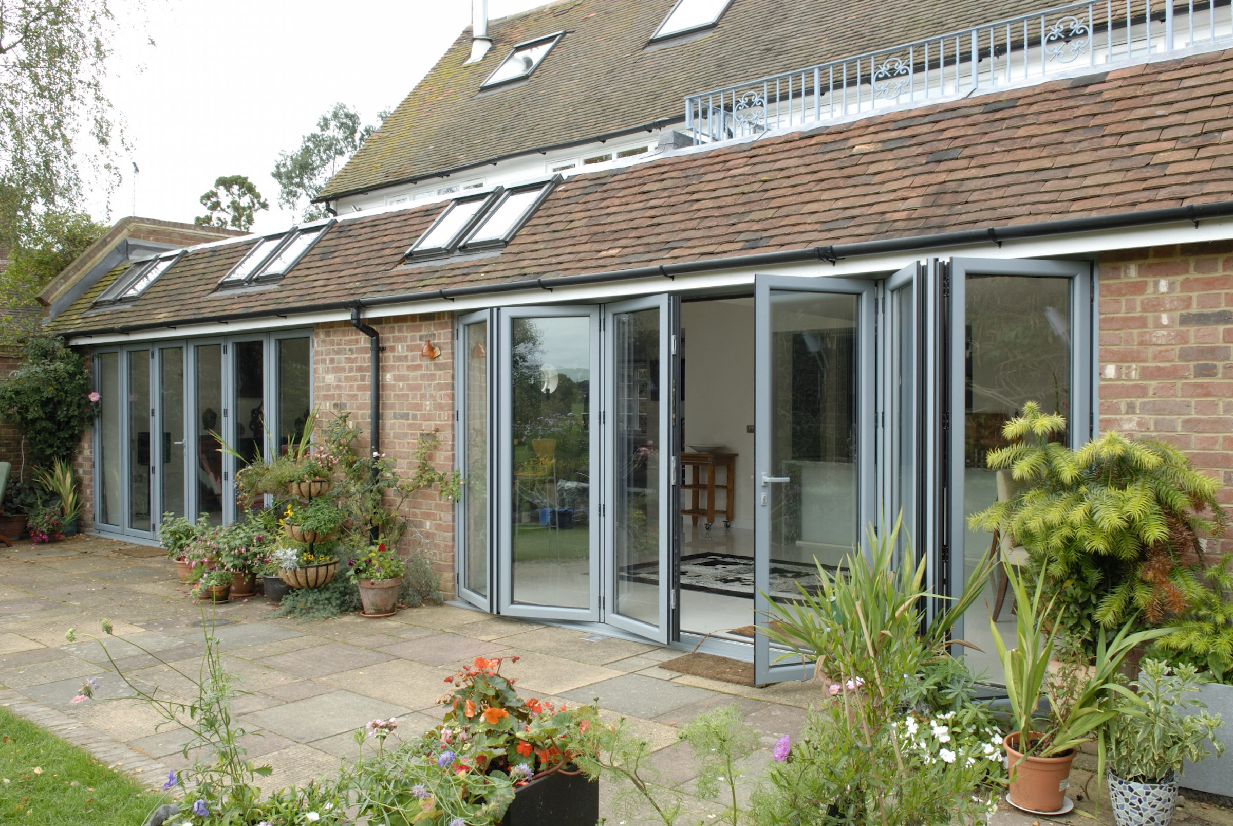 visofold 2000 bifold doors in a traditional house extension
