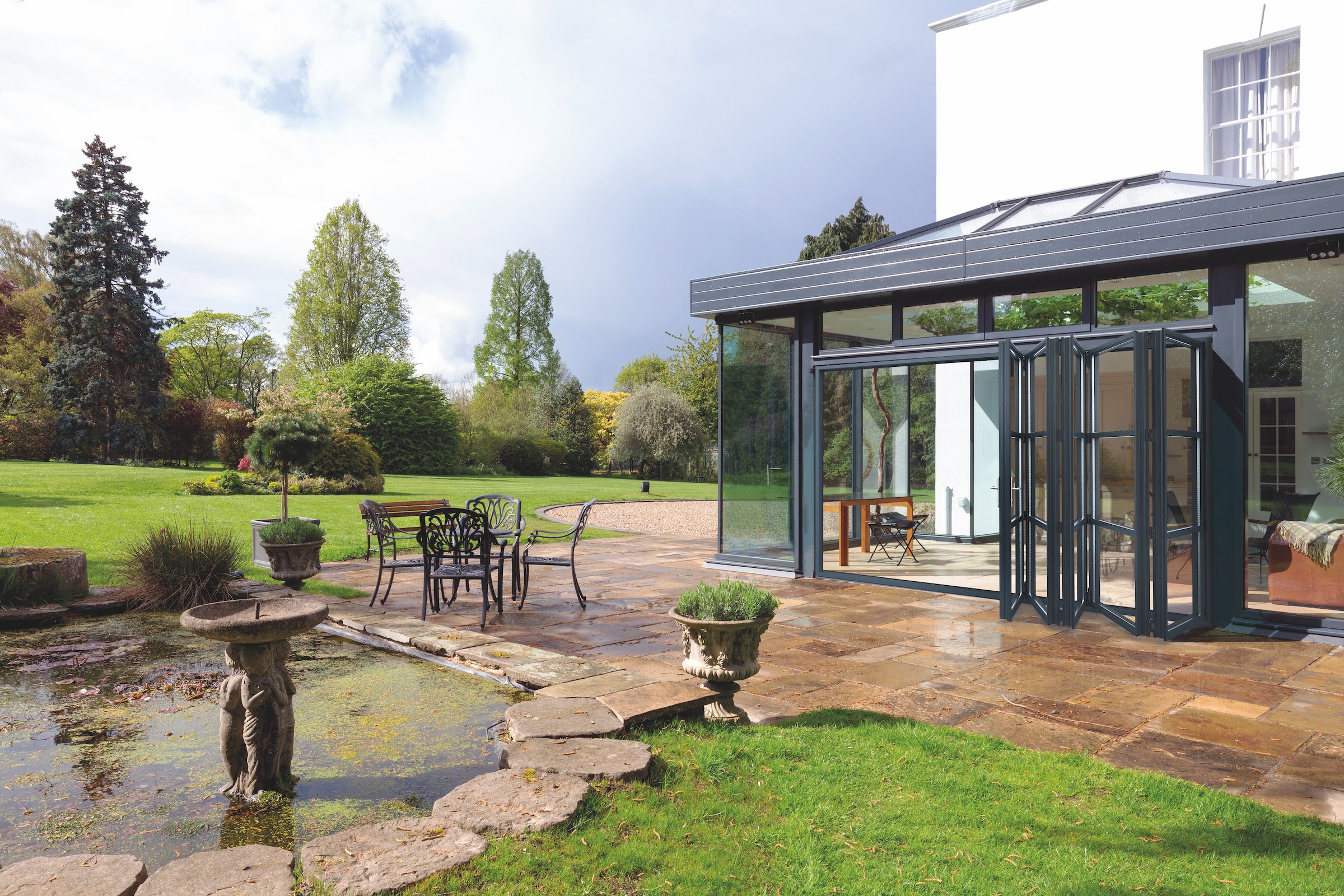 smart systems grey bifolds in a glass extension country home