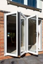 The SAPA Crown Bifolding door benefits from a continuous hinge and an integral D handle with shootbolt locking.