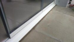 Frameless glass door threshold.