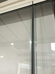 Only a gasket between the doors. Other doors rely on aluminium or plastic profile.