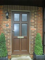 the introduction of the origin midrail offers new scope for bespoke door designs such as this wood effect aluminium entrance door.