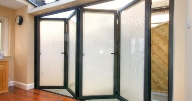 Aluminium integral blinds in a bifold.