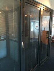 these schuco bifolding doors feature integral glass blinds from market leading morley glass.