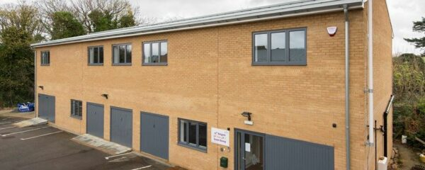 origin windows have been successfully installed in this commercial building used by a local scout group.