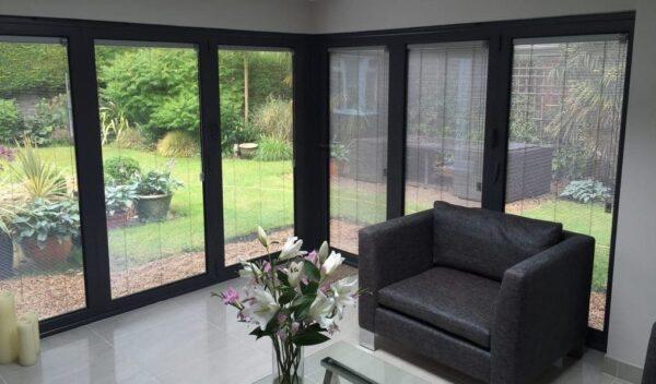 Integral blinds for sliding patio doors
