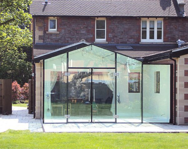 Glass door with patch fittings in extension.