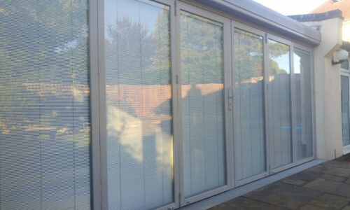 Integral blinds in lean to conservatory.