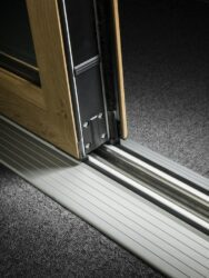 The part M threshold addresses the requirement for easy access in commercial environments.