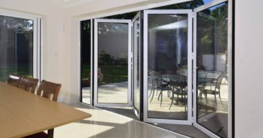 comar bifolding doors in white to new house extension.