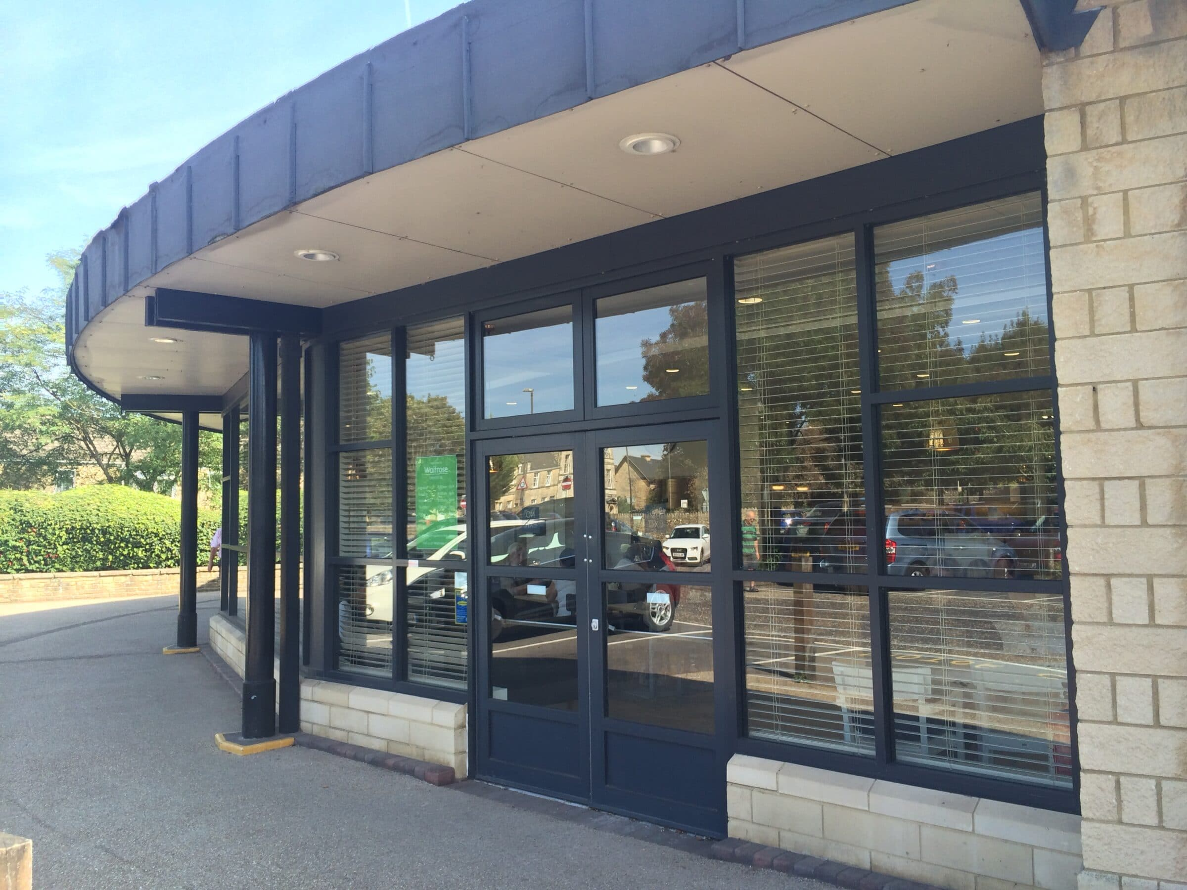 grey commercial shopfronts and screens
