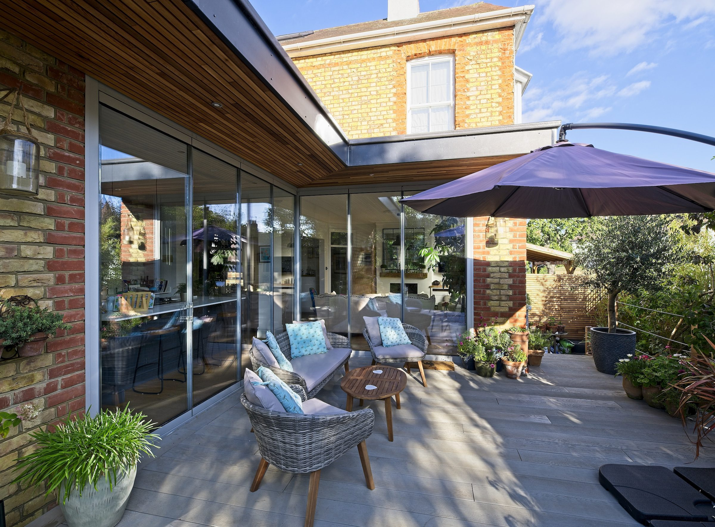 frameless slide and turn patio doors in a character home