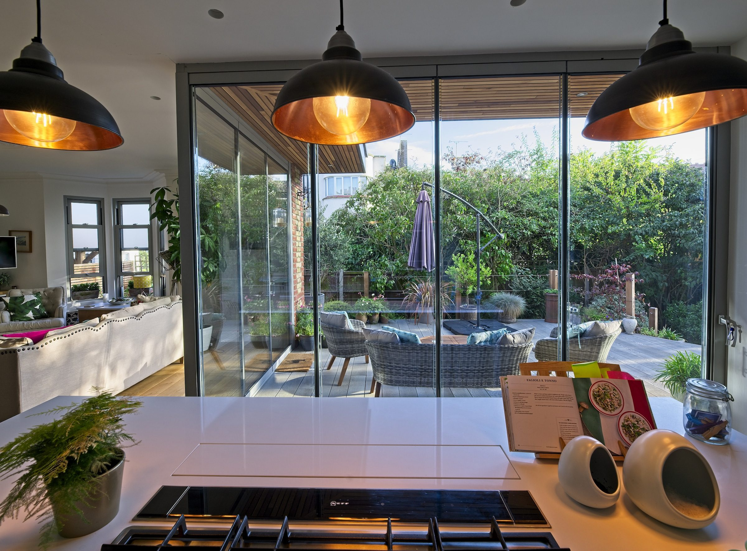 slide and turn doors in a frameless design fitted to a kitchen