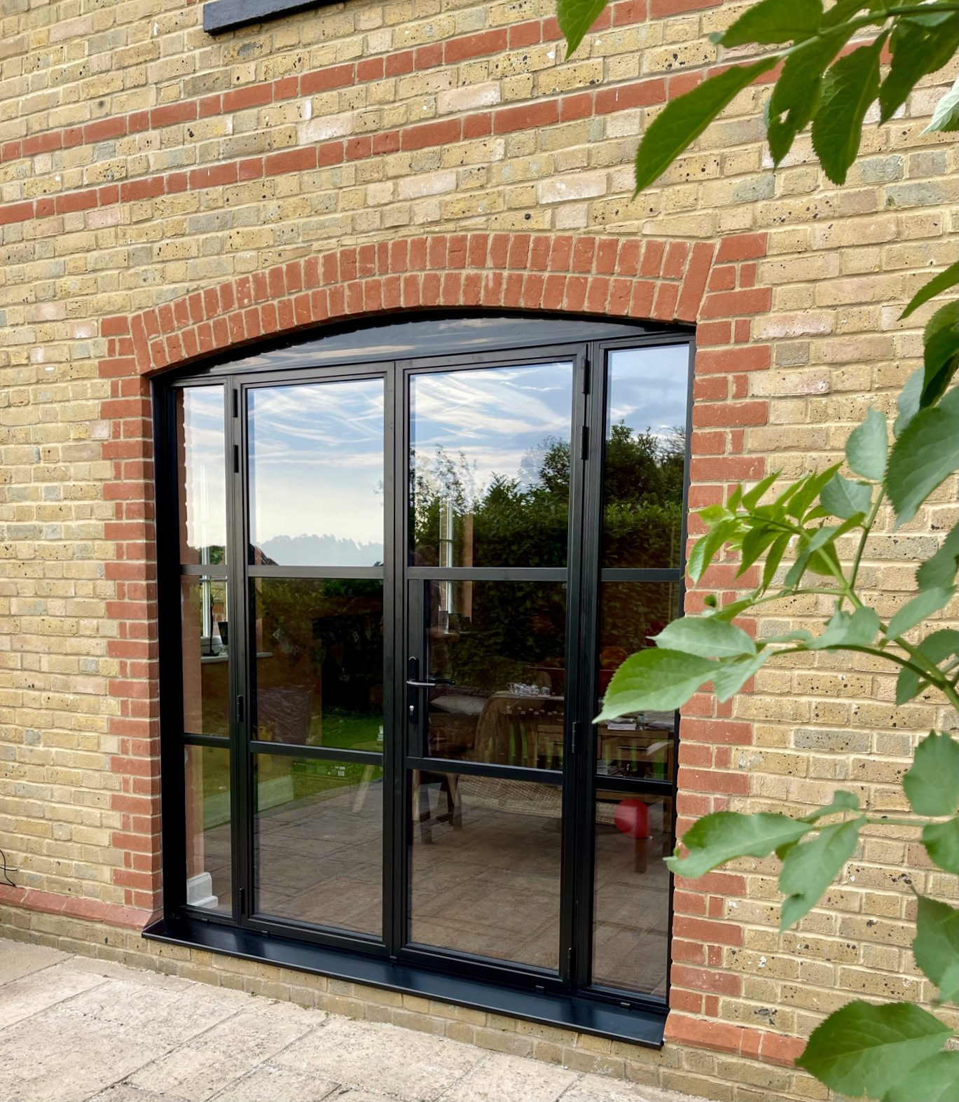 aluminium Crittall style door in black in a traditional house