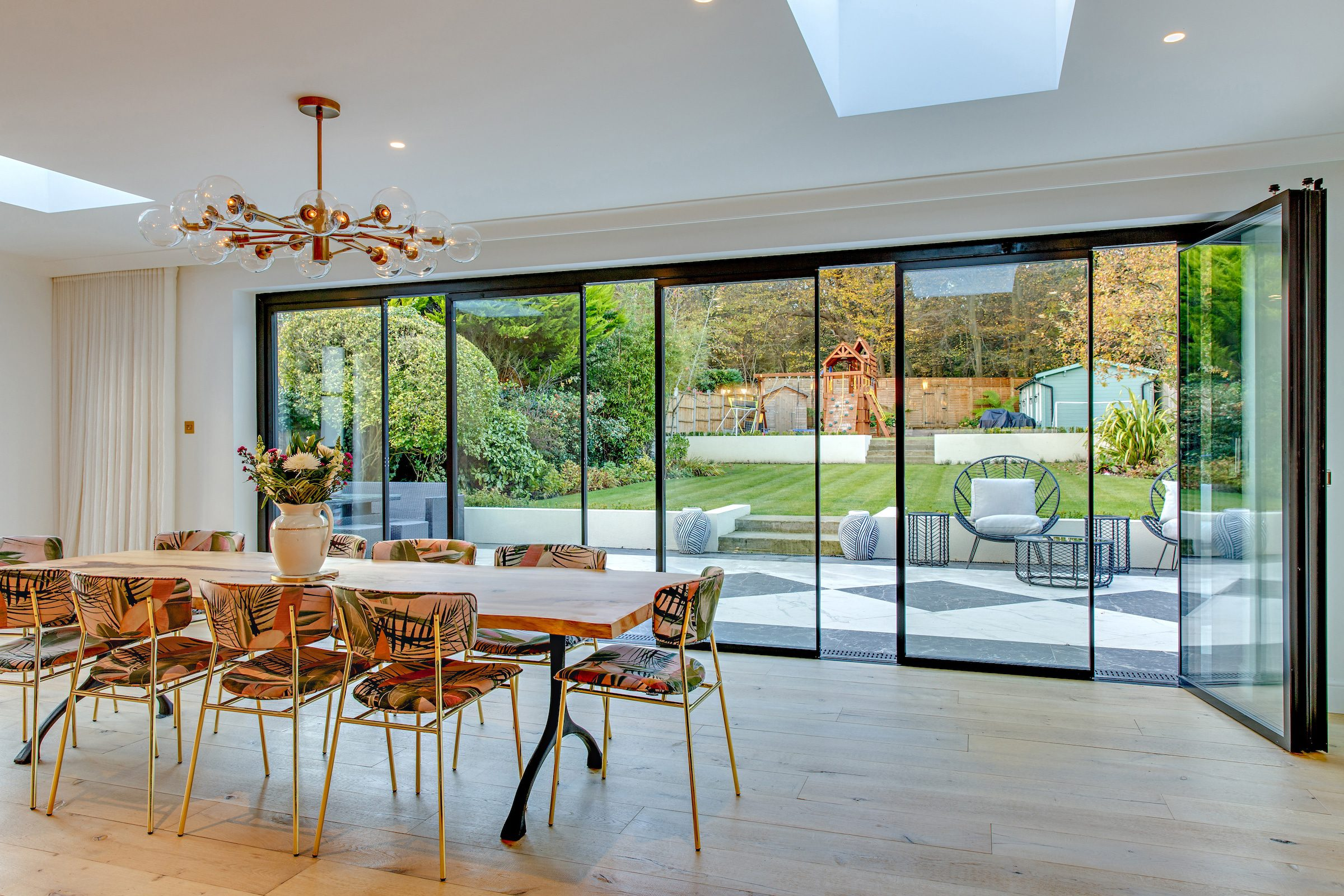 vistaline slide and stack doors partially open in a new lounge extension