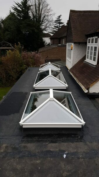 choosing a roof lantern showing three white roofs in a row